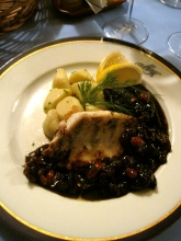 grilled perch in traditional plum nut sauce