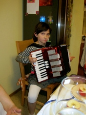 Alenka playing jingle bells on her accordion