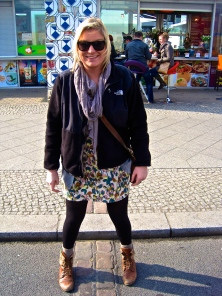 standing in east and west berlin